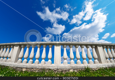 Balustrade Pillars on a Cloudy Sky stock photo, Old white stone balustrade on green grass with blue sky and clouds in the background by catalby