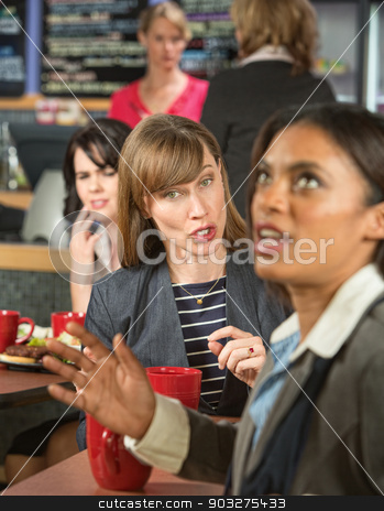 Bothering Coworker at Lunch stock photo, Woman bothering coworker in cafeteria at work by Scott Griessel
