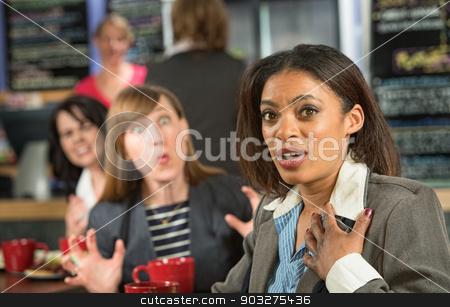Distressed Woman in Cafe stock photo, Person teasing distressed woman in coffee house by Scott Griessel
