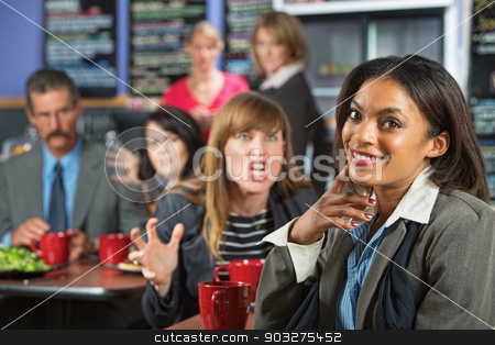 Clueless Happy Woman stock photo, Angry business woman threatening coworker in cafeteria by Scott Griessel