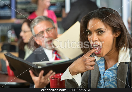 Disgusted Worker with Man stock photo, Disgusted business woman gagging while man reads to her by Scott Griessel