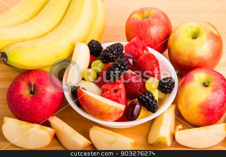 Cut Fruit in Bowl with Bananas and Whole and Cut Apples stock photo, A bowl of fresh cut fruit with whole fruit by Darryl Brooks