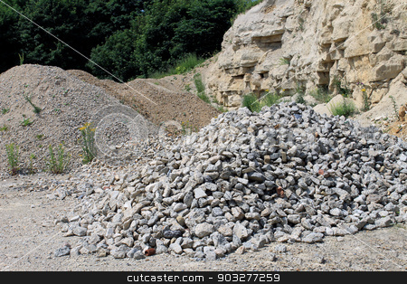 Rocks in a quarry stock photo, Scenic view of rock piles in a quarry. by Martin Crowdy