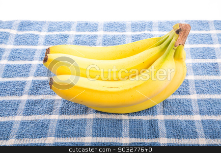 Yellow Bananas on Blue Towel stock photo, A bunch of yellow bananas on a blue towel by Darryl Brooks