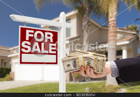 Buyer Handing Over Cash for House with For Sale Sign stock photo, Buyer Handing Over Cash for House with Home and For Sale Real Estate Sign Behind. by Andy Dean