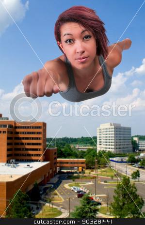 Super Hero stock photo, Beautiful woman super hero flying through the sky by Robert Byron