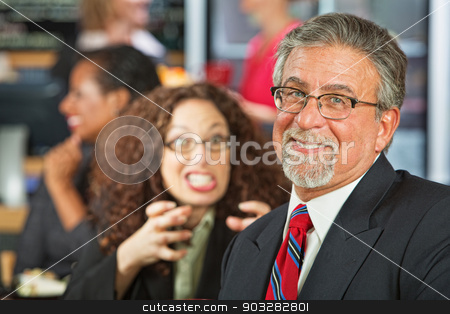 Naive Businessman stock photo, Angry woman trying to strangle naive businessman by Scott Griessel