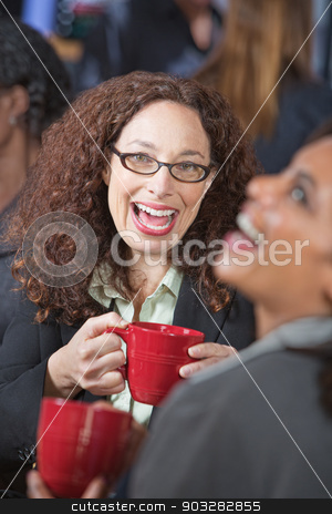 Friends Laughing Together stock photo, Pair of female friends laughing together in cafe by Scott Griessel