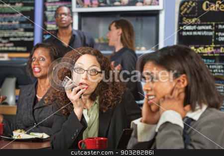 Rude Woman on Phone stock photo, Upset customers in cafe with loud woman on phone by Scott Griessel