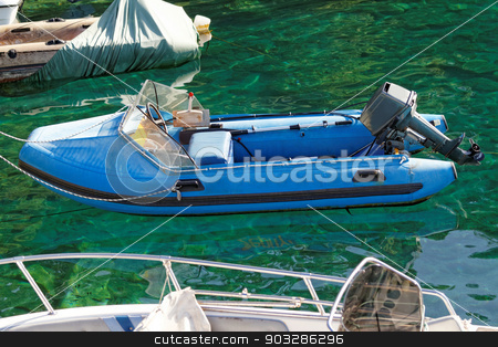 Motorboat  stock photo, Photo of a blue motorboat in the sea by Nneirda