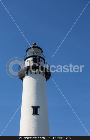 Black and White Lighthouse on Blue stock photo, A white brick lighthouse with black iron hardware on a clear blue sky by Darryl Brooks