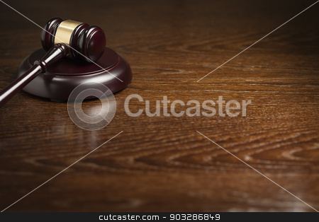 Wooden Gavel Abstract on Table stock photo, Dark Wooden Gavel Abstract on Table with Room for Text. by Andy Dean