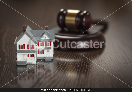Gavel and Small Model House on Table stock photo, Gavel and Small Model House on Wooden Table. by Andy Dean