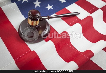 Gavel Resting on American Flag stock photo, Justice Gavel Resting on an American Flag. by Andy Dean