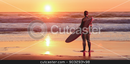 Surfer watching the waves stock photo, Surfer watching the waves at sunset in Portugal. by Homydesign