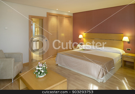 Hotel bedroom interior in warm tone stock photo, Hotel bedroom interior in warm tone. Horizontal format by ABBPhoto