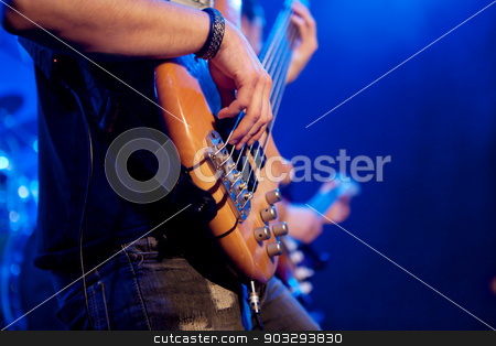 young man playing bass live. Body. stock photo, Boy hands touching the strings of a bass. live concert by Ainat