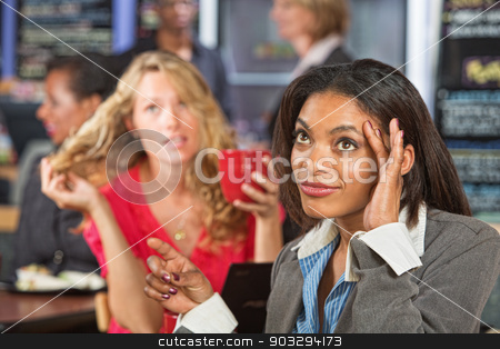 Annoyed Woman in Cafe stock photo, Annoyed Black woman talking with emotional friend by Scott Griessel