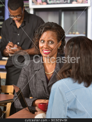 Happy Lady in Cafe stock photo, Happy Black business woman with friend in restaurant by Scott Griessel