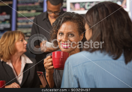 Glad Woman Drinking Tea stock photo, Beautiful business woman holding red coffee mug by Scott Griessel