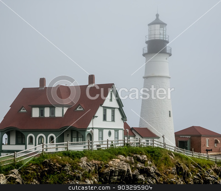 House and Lighthouse in Portland stock photo, The famous Portland Head lighthouse in heavy fog by Darryl Brooks