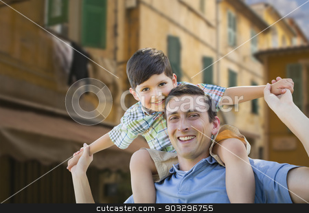 Father and Son Playing Piggyback on Streets of France stock photo, Mixed Race Father and Son Playing Piggyback on the Streets of France. by Andy Dean