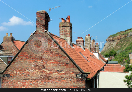 Tiled English houses stock photo, Red tiled houses in the town of Whitby, North Yorkshire, England. by Martin Crowdy