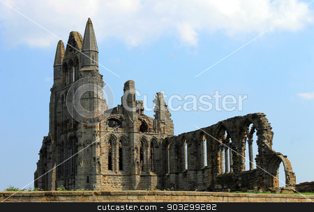 Whitby Abbey stock photo, Scenic view of the ruins of Whitby Abbey with blue sky and cloudscape background. by Martin Crowdy