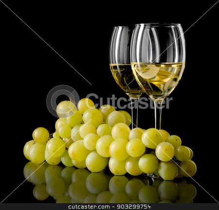 White wine and grapes stock photo, Two glasses of white wine and a bunch of grapes isolated on black by Tadeusz Wejkszo