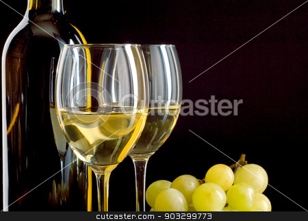 Bottle of wine and a bunch of white grapes stock photo, A bottle and a glass of white wine and a bunch of white grapes on black background by Tadeusz Wejkszo