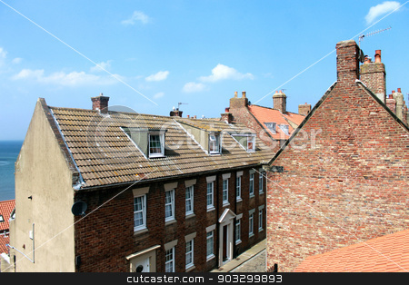 Whitby town houses stock photo, Whitby town houses over looking the sea, North Yorkshire, England. by Martin Crowdy