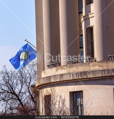 US Federal Trade Commission FTC Flag Washington DC stock photo, US Federal Trade Commission FTC Flag in Washington DC.  US Federal Trade Commission is a US Competition independent agency in Washington DC.  The FTC handles antitrust and false advertising and other competion issues to protect consumers. by William Perry