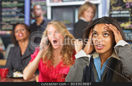 Annoyed Business Woman stock photo, Annoyed lady listening to obnoxious woman on phone by Scott Griessel