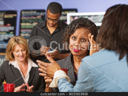 Business Woman with Headache stock photo, Overwhelmed female business person with headache listening to friend by Scott Griessel
