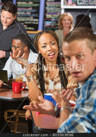 Mixed Couple Arguing stock photo, Mixed Black and white couple arguing in a cafe by Scott Griessel