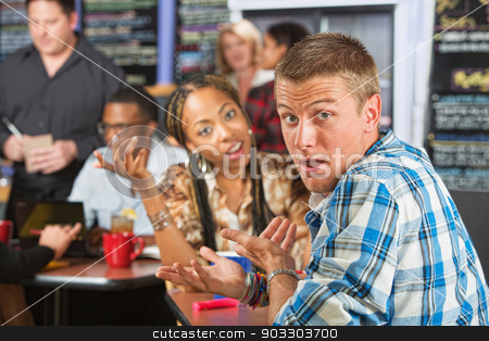 Bickering Young Couple stock photo, Bickering young married couple sitting in coffee house by Scott Griessel