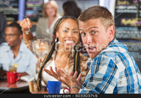 Rude Man and Angry Woman stock photo, Angry young woman threatening rude man in cafe by Scott Griessel