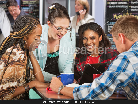 People Doing Homework stock photo, Enthusiastic group of friends studying in cafe by Scott Griessel
