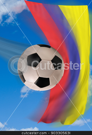 Colombian Soccer. stock photo, Soccer ball flying fast with Colombian flag in background. by WScott