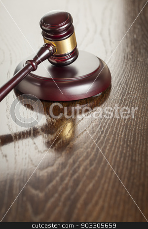 Wooden Gavel Abstract on Reflective Table stock photo, Dark Wooden Gavel Abstract on Reflective Table with Room for Text. by Andy Dean