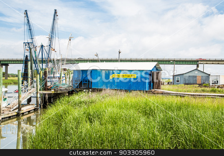 Blue Building by Shrimp Boats stock photo, Shrimp boats docked by a salt water marsh by Darryl Brooks