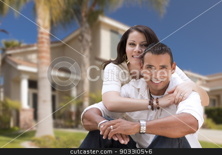Happy Hispanic Young Couple in Front of Their New Home stock photo, Young Happy Hispanic Young Couple in Front of Their New Home. by Andy Dean