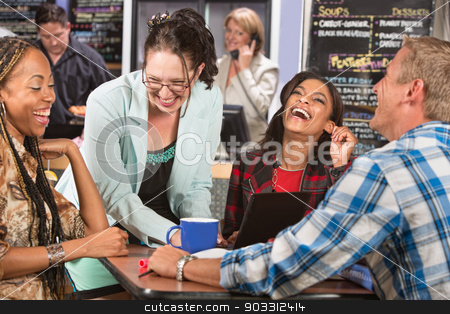 Laughing Group of Students stock photo, Laughing group of students with laptop in cafe by Scott Griessel