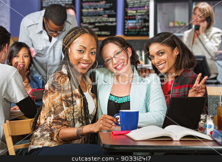 Three Happy Students stock photo, Three smiling friends doing homework together in cafe by Scott Griessel