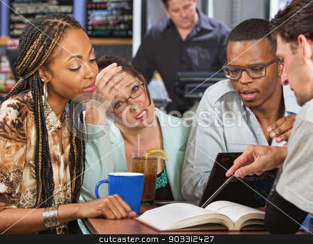 Students Cramming stock photo, Worried young student with friends studying in cafe by Scott Griessel