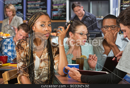 Perplexed Student stock photo, Perplexed beautiful African student studying with friends by Scott Griessel