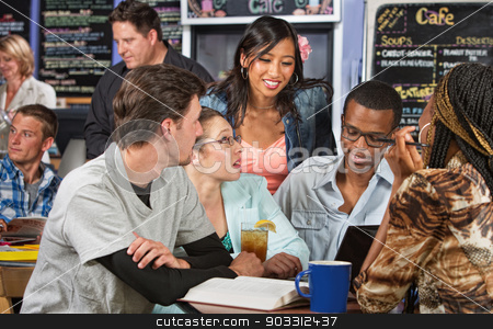Diverse Students with Textbook stock photo, Enthusiastic diverse group of students with textbook in cafe by Scott Griessel