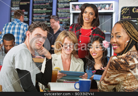 Smiling Diverse Students stock photo, Mixed group of students with tablet computer in cafe by Scott Griessel
