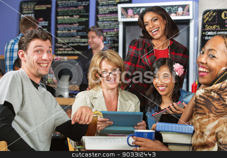 Students Laughing stock photo, Diverse group of students laughing in coffee house by Scott Griessel