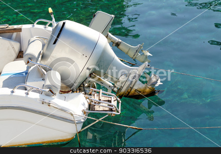 Motorboat engine stock photo, Photo of a grey motorboat engine in the sea by Nneirda